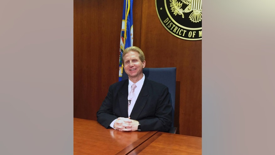 Kevin Lowry, chief U.S. probation officer for Minnesota poses for a photo, Wednesday, Sept. 21, 2016 in Minneapolis., Kevin Lowry, who says his office can successfully implement the program. The federal probation office in Minneapolis has trained 20 to 25 probation officers in de-radicalization methods developed by the German Institute on Radicalization and De-radicalization Studies.  Lowry says his office can successfully implement the program. (AP Photo/Steve Karnowski)