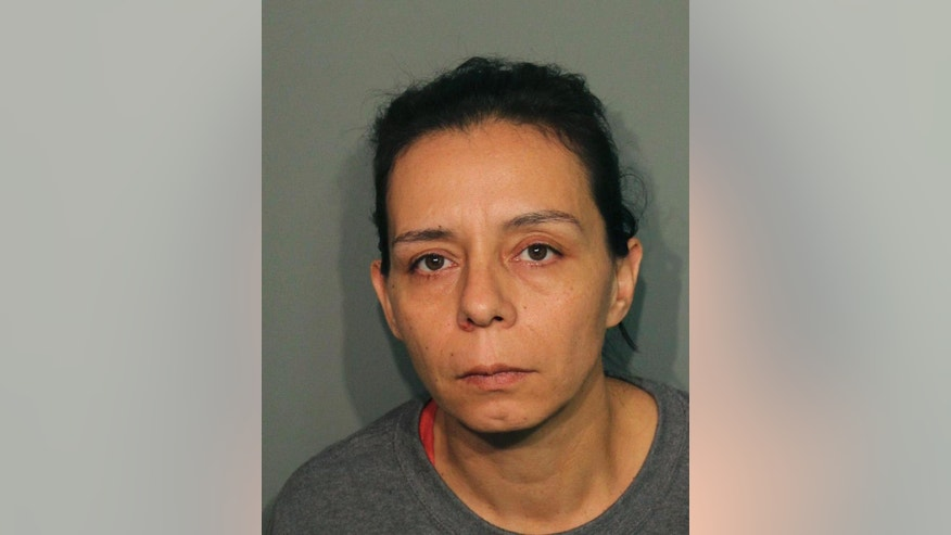 RETRANSMISSION TO CORRECT SPELLING OF SURNAME TO ARELLANO - This booking photo released Wednesday, Sept. 21, 2016, by the Calaveras County Sheriff's Office shows Guadalupe Sierra Arellano in San Andreas, Calif. Arellano is one of two women arrested on charges of holding multiple men captive at an illegal marijuana plantation in Northern California and forcing them to work there for several months. Calaveras County Sheriff's Capt. Jim Macedo said Wednesday the men fled the secluded, rural camp in July after overhearing they would be murdered after the harvest. (Calaveras County Sheriff's Office via AP)