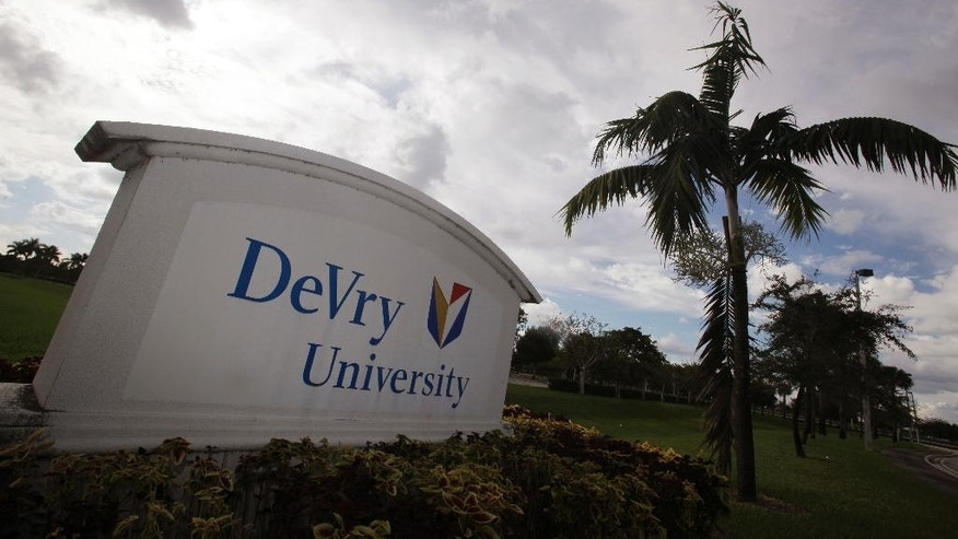 FILE - This Nov. 24, 2009, file photo, shows the entrance to the DeVry University in Miramar, Fla. Some of the nation's largest for-profit college chains are suffering steep declines in enrollment amid heavier government scrutiny. DeVry University says the number of students taking classes is down 23 percent this year, and the University of Phoenix is off 22 percent. (AP Photo/J Pat Carter, File)