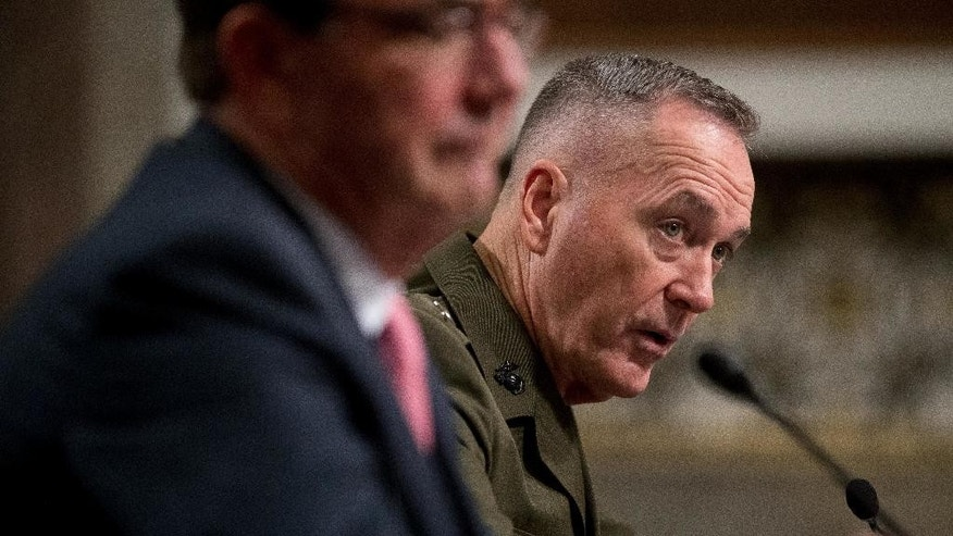 Joint Chiefs Chairman Gen. Joseph Dunford, right, accompanied by Defense Secretary Ash Carter, testifies on Capitol Hill in Washington, Thursday, Sept. 22, 2016, before the Senate Armed Services Committee hearing. Dunford said he does not believe it would be a good idea for the U.S. military to share intelligence with Russia in Syria. (AP Photo/Andrew Harnik)