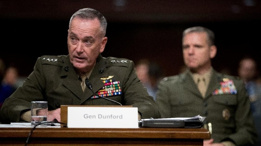 Joint Chiefs Chairman Gen. Joseph Dunford testifies on Capitol Hill in Washington, Thursday, Sept. 22, 2016, before the Senate Armed Services Committee hearing. Dunford and Defense Secretary Ash Carter faced sharp questions from Republicans angry that the Obama administration is not taking more aggressive steps to end the 5-year-old-civil war in Syria.   (AP Photo/Andrew Harnik)