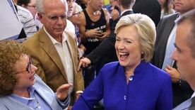 Democratic presidential nominee Hillary Clinton meets and greets supporters during a campaign stop in Orlando, Fla., Wednesday, Sept. 21, 2016.  (Joe Burbank/Orlando Sentinel via AP)