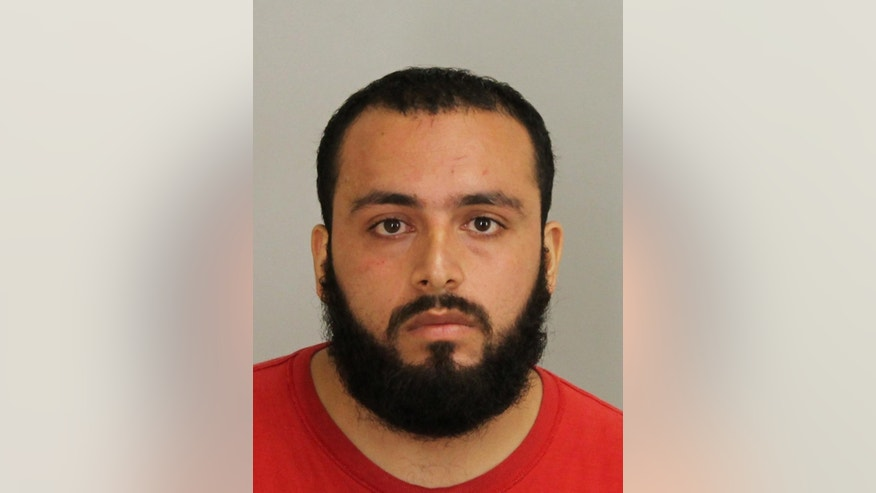 FILE - This September 2016 file photo provided by Union County Prosecutor's Office shows Ahmad Khan Rahami, who is in custody as a suspect in the weekend bombings in New York and New Jersey. Rahami worked as an unarmed night guard for two months in 2011 at an AP administrative technology office in Cranbury, N.J. At the time, he was employed by Summit Security, a private contractor. Rahami remained hospitalized Tuesday, Sept. 20, 2016, after a shootout the day before with police in New Jersey. (Union County Prosecutor's Office via AP, File)