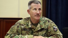 FILE - In this July 27, 2016 file photo, U.S. Army Gen. John Nicholson is interviewed by The Associated Press at his office in Kabul, Afghanistan. The Taliban have control over 10 percent of Afghanistan's population and the insurgent group is battling with the Afghan government for control of at least another 20 percent, the top U.S. commander in Afghanistan said Friday, Sept. 23, 2016, describing a tough fight that is costing a high level of Afghan casualties. Nicholson said many of the Afghan deaths are in battles over checkpoints, where there are often a small number of forces who are poorly led, ill-equipped and not well trained.  (AP Photo/Massoud Hossaini, File)
