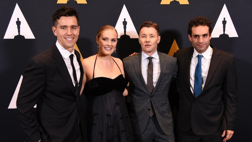 Presenter Joel Edgerton, second from right, poses with student Academy Award winners in the narrative category at the 43rd Annual Student Academy Awards at the Academy of Motion Picture Arts and Sciences on Thursday, Sept. 22, 2016, in Beverly Hills, Calif. From left are Brian Robau and Brenna Malloy of Chapman University in California and Jimmy Keyrouz of Columbia University in New York. (Photo by Chris Pizzello/Invision/AP)