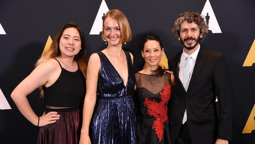 Presenter Lucy Liu, second from right, poses with student Academy Award winners in the animation category at the 43rd Annual Student Academy Awards at the Academy of Motion Picture Arts and Sciences on Thursday, Sept. 22, 2016, in Beverly Hills, Calif. From left are Echo Wu of Ringling College of Art and Design in Florida, Alicja Jasina of the University of Southern California and foreign film animation category winner Ahmad Saleh of the Academy of Media Arts Cologne in Germany. (Photo by Chris Pizzello/Invision/AP)