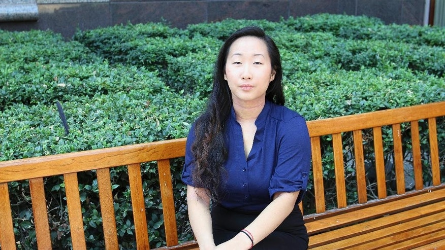 Yee Xiong, 24, sits for a photo at her attorney's office in Sacramento, Calif., on Aug. 12, 2016. As she prepared to leave the sentencing hearing for Lang Her, who she said sexually assaulted her when they were students, she felt ready to finally put the case behind her after four years. Then, she was handed a $4 million defamation lawsuit. (AP Photo/Darcy Costello)