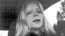 FILE - In this undated file photo provided by the U.S. Army, Pfc. Chelsea Manning poses for a photo wearing a wig and lipstick.