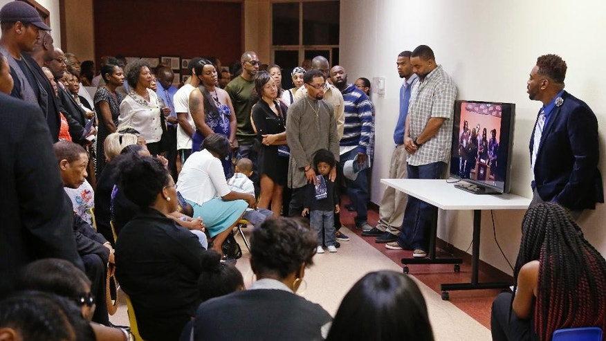 An overflow crowd watches the funeral of Terence Crutcher in the lobby of the church in Tulsa, Okla., Saturday, Sept. 24, 2016. Crutcher was fatally shot Sept. 16 by Officer Betty Jo Shelby. (AP Photo/Sue Ogrocki)