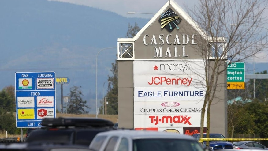 A sign for the Cascade Mall is shown Saturday, Sept. 24, 2016, in Burlington, Wash. Authorities said Saturday several people were dead after the shooting Friday night and the suspect was still at large. The identity of the suspect, his motive and how he got a rifle into the mall remained unanswered. (AP Photo/Ted S. Warren)