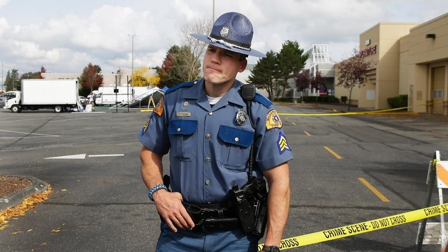 Washington State Patrol Sgt. Mark Francis, a public information officer, talks to reporters Saturday, Sept. 24, 2016, at the Cascade Mall in Burlington, Wash.  Authorities said Saturday several people were dead after the shooting Friday night and the suspect was still at large. The identity of the suspect, his motive and how he got a rifle into the mall remained unanswered. (AP Photo/Ted S. Warren)