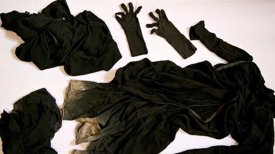 FILE - Clothing worn by a Yazidi girl enslaved by Islamic State militants, collected by a Yazidi activist to document Islamic State group crimes against the community, shown in this file photo taken May 22, 2016, in Dohuk, northern Iraq. Lawyers in Europe investigating the Islamic State's elaborate operation to kidnap thousands of women as sex slaves say they have enough evidence to try IS leaders with crimes against humanity, but two years after the IS onslaught against the Yazidi people, the Obama administration has made little effort to pursue prosecution. Current and former U.S. State Department officials say that a push for a legal finding of genocide in late 2014 was quashed by the Defense Department. (AP Photo/Maya Alleruzzo, File)