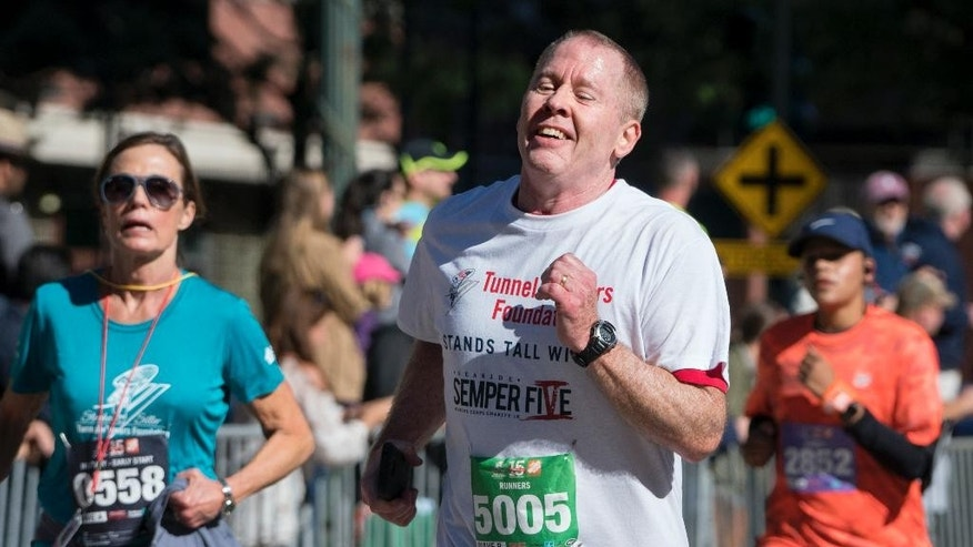 "Robert Schenk, of Brick N.J., nears the finish line during the ""Stephen Siller Tunnel to Towers"" memorial event in New York, Sunday, Sept. 25 2016. The sponsors of the run honoring New York firefighter Stephen Siller, who died at the World Trade Center on Sept. 11, 2001, invited participants, including Schenk, of the Seaside, N.J., Semper Five Marine Corps charity run that was cancelled last week after a pipe bomb exploded along the route. (AP Photo/Craig Ruttle)"