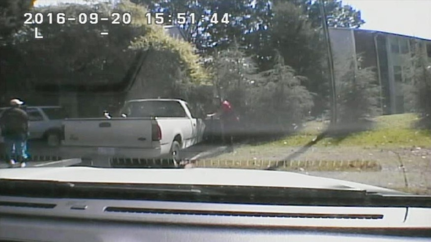 This image made from video provided by the Charlotte-Mecklenburg Police Department on Saturday, Sept. 24, 2016 shows Keith Scott, left, moments before he was fatally shot by police in Charlotte, N.C., on Sept. 20, 2016. (Charlotte-Mecklenburg Police Department via AP)