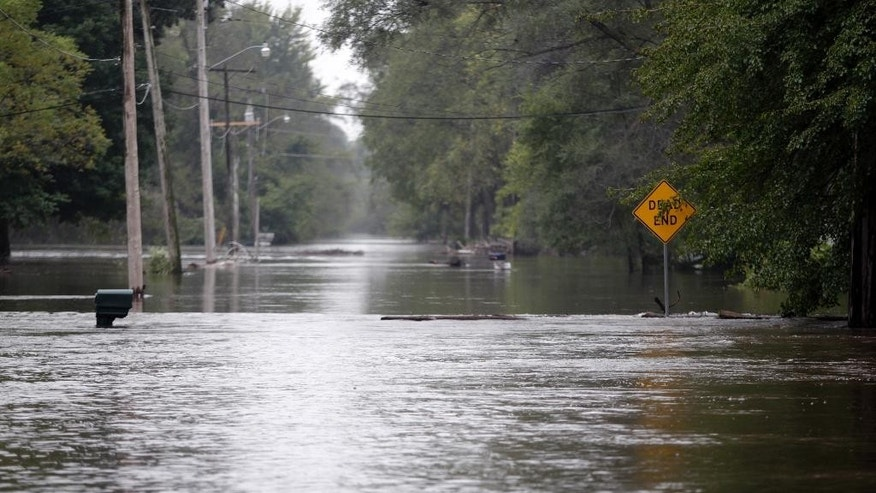 Flood waters close McCoy Road  on Saturday, Sept. 24, 2016, in Evansdale, Iowa. Authorities in several Iowa cities were mobilizing resources Friday to handle flooding from a rain-swollen river that has forced evacuations in several communities upstream.  (Tiffany Rushing/The Courier via AP)