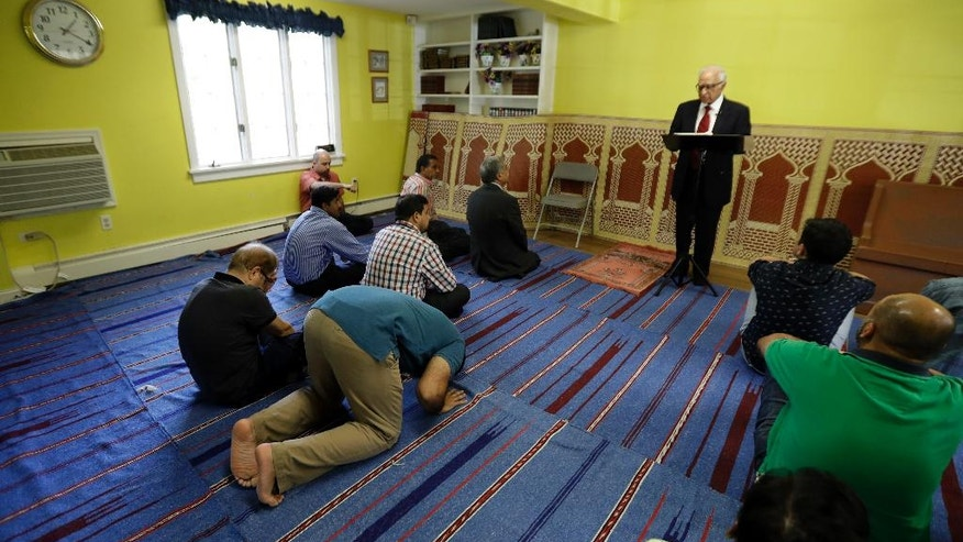 In a photo taken Friday, Sept. 23, 2016, in Basking Ridge, N.J., Iftakhar Ahmad, top, a visiting religious leader from Pakistan, leads a prayer service at the Bernards Township Community Center. The case of the New Jersey Muslim charged with planting bombs in New York and New Jersey is the latest of many challenging moments for the state's large Muslim population. They have been a target of anti-Muslim rhetoric in the presidential campaign and have seen their governor, once considered a strong ally, endorse a presidential candidate who has thrown suspicion on their entire community. (AP Photo/Julio Cortez)