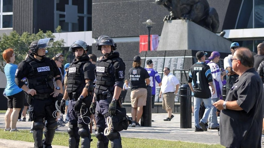 Police officers stand outside Bank of America Stadium for an NFL football game between the Minnesota Vikings and the Carolina Panthers, Sunday, Sept. 25, 2016. Extra security was posted outside the stadium in response to protests over the shooting death of a black man by a police officer on Sept. 20. (AP Photo/Skip Foreman)