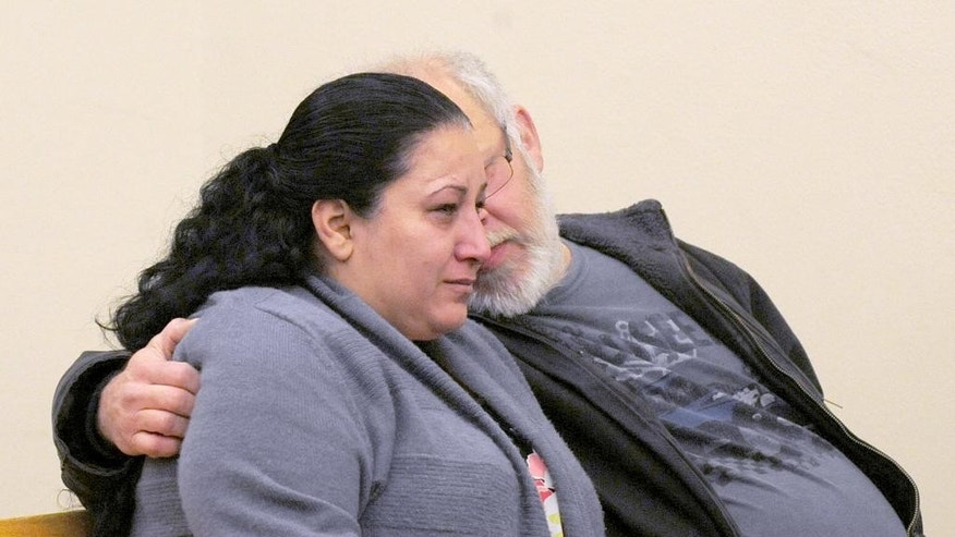 Arcan Cetin's mother cries openly in Skagit County District Court on Monday, Sept. 26, 2016 before her son appeared before the judge under a magistrate's warrant which will give Skagit County prosecutors 30 days to file official charges against him in the Cascade Mall shooting where five people were murdered on Friday, Sept. 22, in Burlington. (Brandy Shreve/Skagit Valley Herald via AP)
