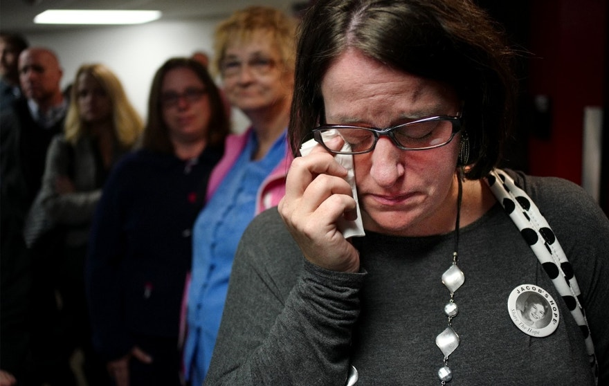Leslie Bergwall weeps at a memorial service of abduction victim Jacob Wetterling at the Clemens Field House on the College of Saint Benedict in St. Joseph, Minn. Wetterling's abduction 27 years ago at the age of 11, prompted new laws to protect children. Earlier this month, Danny Heinrich admitted that he abducted, sexually assaulted and shot Jacob to death, then buried the boy's body in a field in rural central Minnesota. (Richard Tsong-Taatarii/Star-Tribune via AP)
