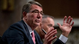 """FILE - In this Sept. 22, 2016 file photo, Defense Secretary Ash Carter, accompanied by Joint Chiefs Chairman Gen. Joseph Dunford, testifies on Capitol Hill in Washington. As defense chief for a president who famously envisioned """"a world without nuclear weapons,"""" Ash Carter has said remarkably little about them. He has been quiet on a range of nuclear issues, including the Pentagon's efforts to correct an array of morale, training, discipline and resource problems in the Air Force nuclear missile corps. This is all the more notable for the fact that Carter, a physicist by training and policy wonk by reputation, cut his professional teeth on nuclear weapons during the Cold War. This quiet approach is expected to end when Carter visits Minot Air Force Base in North Dakota on Monday, Sept. 26, 2016. (AP Photo/Andrew Harnik, File)"""