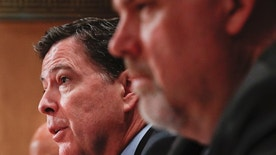 FBI Director James Comey, center, flanked by Homeland Secretary Jeh Johnson, left, and Director of National Counterterrorism Center, Office of the National Intelligence, Nicholas J. Rasmussen, testifies on Capitol Hill in Washington, Tuesday, Sept. 27, 2016, before the Senate Homeland Security and Governmental Affairs Committee hearing on on terror threats. (AP Photo/Pablo Martinez Monsivais)