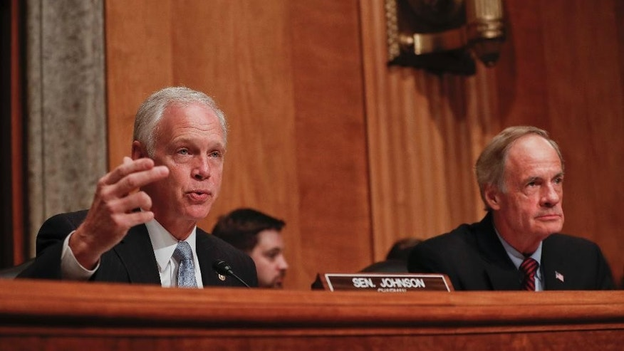 Senate Homeland Security and Governmental Affairs Committee Chairman Sen. Ron Johnson, R-Wis., left, accompanied by the committee's ranking member Sen. Tom Carper, D-Del., speaks on Capitol Hill in Washington, Tuesday, Sept. 27, 2016, during the committee's hearing on on terror threats.  (AP Photo/Pablo Martinez Monsivais)