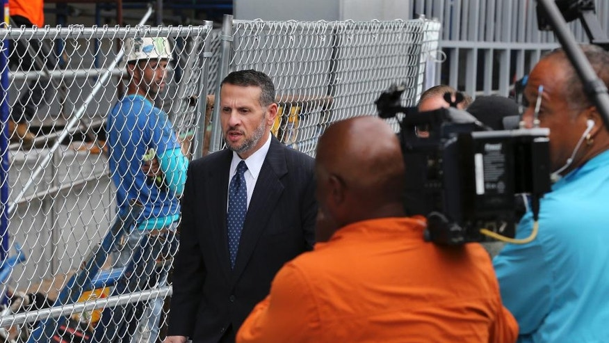 David Wildstein leaves Martin Luther King Jr. Federal Courthouse after a hearing, Monday, Sept. 26, 2016, in Newark, N.J. Wildstein, pleaded guilty last year to orchestrating traffic jams in 2013 to punish a Democratic mayor who didn't endorse New Jersey Gov. Chris Christie. Three years after gridlock paralyzed a New Jersey town next to the George Washington Bridge for days, two former allies of Christie, Bill Baroni and Bridget Kelly, are being tried, in Newark, N.J. (AP Photo/Mel Evans)