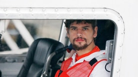 Nathan Carman arrives in a small boat at the US Coast Guard station in Boston, Tuesday, Sept. 27, 2016. Carman spent a week at sea in a life raft before being rescued by a passing freighter. (AP Photo/Michael Dwyer)