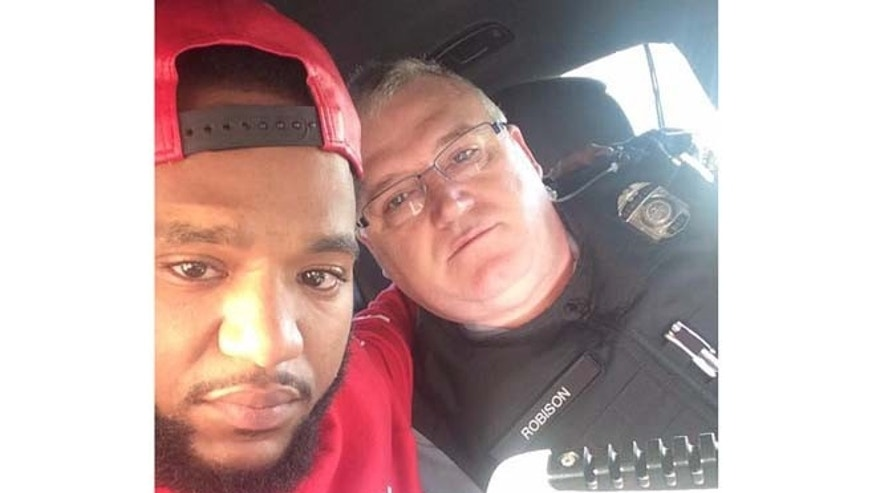 Mark Ross is pictured here in a photo with Sgt. David Robison that was posted to his Facebook page.