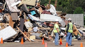 Flood damaged debris is piled up in a parking lot at the Waseca County Fairgrounds Monday, Sept. 26, 2016, in Waseca, Minn.  Hundreds of residents in flood-ravaged Waseca and St. Clair are dealing with property damage while state transportation officials wait for the water to recede to begin inspecting inundated roads and bridges.  (Pat Christman/The Free Press via AP)