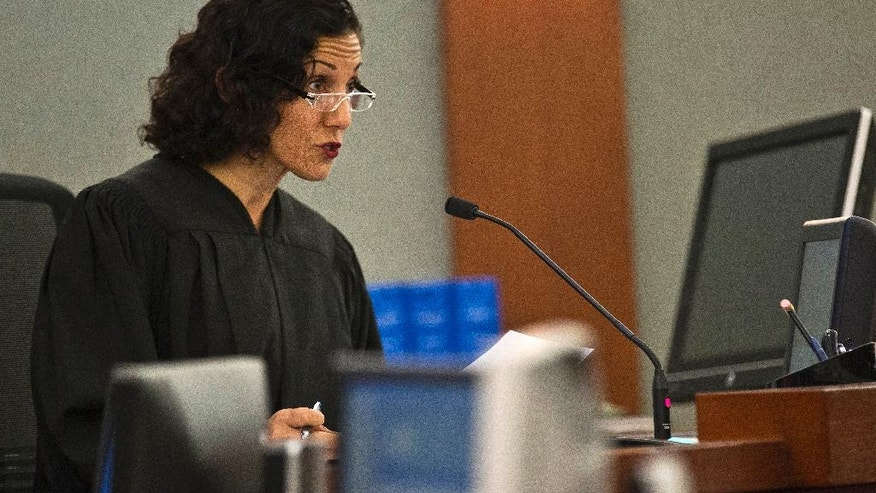 Justice of the Peace Pro Tem Holly Stoberski addresses Pedro Jose Garcia as he makes makes his first court appearance at the Regional Justice Center in Las Vegas Wednesday, Sept. 28, 2016. A court date was postponed until Friday for the ex-felon accused of killing a Starbucks customer during a weekend coffee shop shooting in Las Vegas. (L.E. Baskow/Las Vegas Sun via AP)