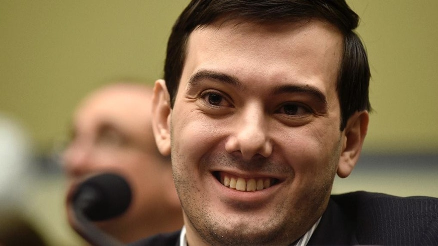 FILE - In this Feb. 4, 2016 file photo, Pharmaceutical chief Martin Shkreli smiles on Capitol Hill in Washington during the House Committee on Oversight and Reform Committee hearing on his former company's decision to raise the price of a lifesaving medicine. Shkreli announced on Twitter Sept. 26, 2016, that he would offer up a chance to punch him in the face as part of a fundraiser for the son of his former PR consultant, who recently died. (AP Photo/Susan Walsh, File)