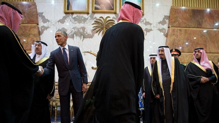 FILE- In this Jan. 27, 2015 file photo, President Barack Obama participates in a receiving line with the Saudi Arabian King, Salman bin Abdul Aziz, at Erga Palace in Riyadh, Saudi Arabia. Saudi Arabia and its allies are warning that legislation allowing the kingdom to be sued for the 9/11 attacks will have negative repercussions. The kingdom maintains an arsenal of tools to retaliate with, including curtailing official contacts, pulling billions of dollars from the U.S. economy, and enlisting its lockstep Gulf allies to scale back counterterrorism cooperation, investments and U.S. access to important regional air bases. (AP Photo/Carolyn Kaster, File)
