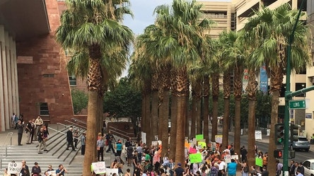 FILE - In this July 29. 2016 file photo, protesters for and against a sweeping Nevada school choice program voice their opinions about the measure being argued before the Nevada Supreme Court in Las Vegas. The Nevada Supreme Court has ruled that the state's voucher-style Education Savings Accounts program, seen as the broadest school choice initiative in the country, has an unconstitutional funding mechanism that should remain blocked. Justices issued a 4-2 ruling on Thursday, Sept. 29, 2016, against the money source for the program, which has been on hold since the winter and never disbursed funds to families as it intended, but upholding some of the major tenets underlying the school voucher concept. (AP Photo/Ken Ritter, File)