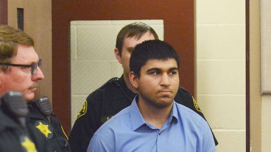 Arcan Cetin is escorted into Skagit County District Court by Skagit County's Sheriff's Deputies on Monday, Sept. 26, 2016. Cetin is being held under a magistrate's warrant which will give Skagit County prosecutors 30 days to file charges in relation to the Cascade Mall shooting that took place on Friday evening. Five people were killed in the shooting, and Cetin is being held on a $2 million bail. (Brandy Shreve/Skagit Valley Herald via AP)