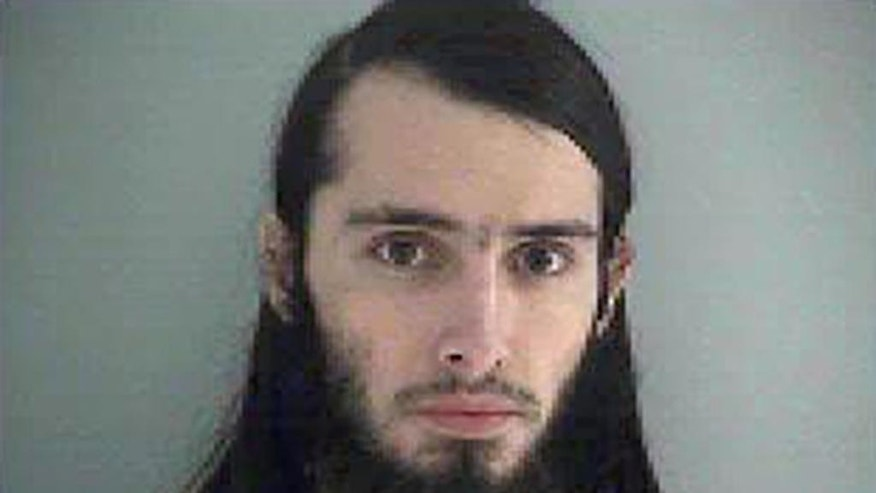 FILE – This Jan. 14, 2015 file photo made available by the Butler County Jail in Hamilton, Ohio, shows Christopher Lee Cornell of Green Township in suburban Cincinnati. The sentencing of Cornell, accused of plotting to attack the U.S. Capitol in support of the Islamic State group, has been rescheduled to Dec. 5, 2016, after he pleaded guilty Aug. 1 to three federal charges stemming from his Jan. 14, 2015, arrest. (Butler County Jail via AP, File)