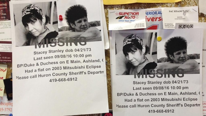 FILE – This Sept. 14, 2016, file photo shows missing person fliers for Stacey Stanley that remained posted on a bulletin board in a laundromat in Ashland, Ohio. Shawn Grate is scheduled to be arraigned Thursday, Sept. 29, 2016, in the Ashland, Ohio, killings of Stanley of Greenwich, Ohio, and another woman, and has pleaded not guilty. Authorities say Grate confessed to killing two other women, one in June 2016 and one around 2005, and is charged in the abduction of a woman rescued Sept. 13, 2016, in Ashland, Ohio. (AP Photo/Ann Sanner, File)