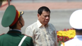 Philippine President Rodrigo Duterte reviews an honor guard with his Vietnamese counterpart Tran Dai Quang during a welcome ceremony at the presidential palace in Hanoi, Vietnam, Thursday, Sept. 29, 2016. Duterte is on a two-day visit to meet Vietnam's leaders. (Hoang Dinh Nam/Pool Photo via AP)