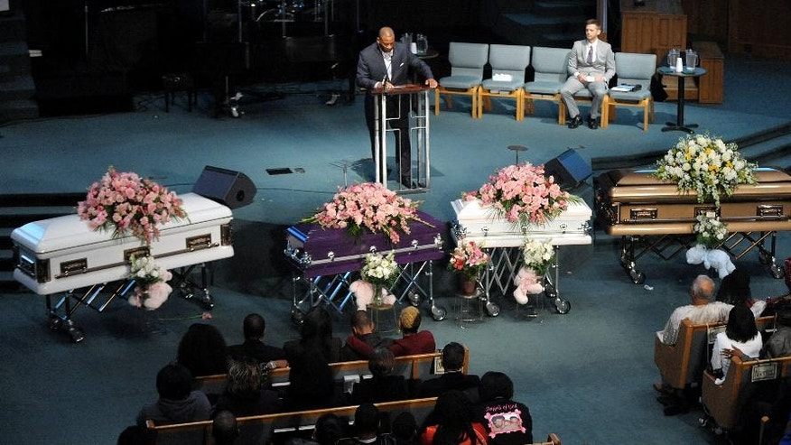 Family and loved ones pay their respects to four siblings who were allegedly killed in their Dearborn Heights home, by Gregory Green, a father to two of the children and a step-father to the two others, before their funeral service at Detroit First Church of the Nazarene in Farmington Hills, Mich., Friday Sept. 30, 2016. (Todd McInturf/Detroit News via AP)