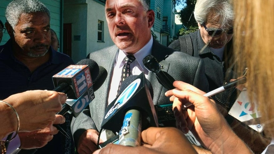 Los Angeles County Sheriff's department homicide Captain Seven D. Katz talks with reporters in front of Orange Grove Gardens as detectives investigate the death of a black man in Pasadena, Calif., on Friday, Sept. 30, 2016. A witness says the man's death occurred after a struggle with police. A sheriff's statement says the death occurred about 2 a.m. Friday but gives no details. (AP Photo/Richard Vogel)