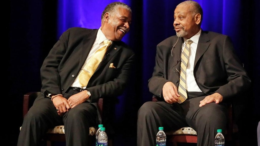 In this Sept. 27, 2016 photo, Godfrey Dillard, left, and Perry Wallace take part in a lecture at Vanderbilt University in Nashville, Tenn. A half-century after Wallace became the first black basketball player in the Southeastern conference, he and former teammate Dillard, returned to the campus as part of a campus-wide discussion on race this year at the elite, private southern university. It's a significant milestone in what has been Vanderbilt's long, sometimes painful journey to become more diverse.  (AP Photo/Mark Humphrey)