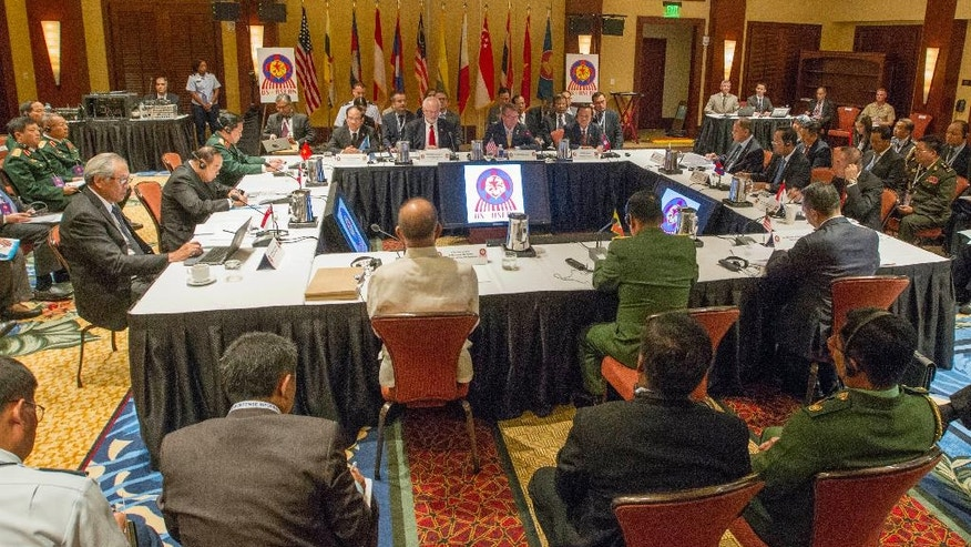 U.S. Secretary of Defense Ash Carter, seated at table background center right, gives his opening remarks for the Association of Southeast Asian Nations (ASEAN) defense ministers meeting in Ko Olina, Hawaii, on Friday, Sept. 30, 2016. (AP Photo/Eugene Tanner)