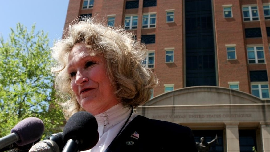 "In this April 20, 2006 photo, Alice Hoagland, whose son Mark Bingham died on United Airline's Flight 93 on September 11, 2001, speaks to reporters in front of U.S. District Court in Alexandria, Va. Congress has allowed Sept. 11 victims to sue Saudi Arabia over claims it had a role in the terror attacks but some judges have questioned the strength of the case. Plaintiffs like Hoagland say just airing their argument in court would be a victory in itself. ""We're less interested in any kind of financial gain than we are in bringing the truly guilty into court and making our case known,"" she said. (AP Photo/Caleb Jones)"