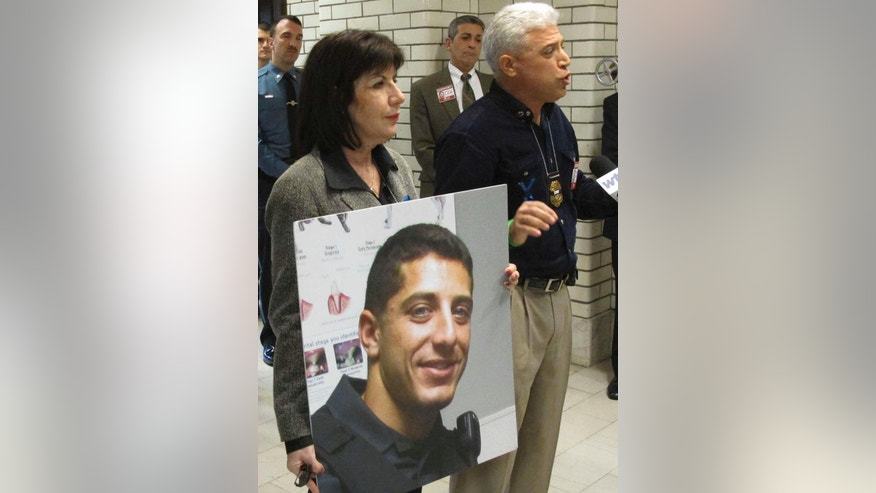 FILE- In this April 9, 2016 file photo, Rich Leotta, the father of police officer Noah Leotta who died after being hit by a suspected drunk driver while on duty last year, addresses Maryland lawmakers in Annapolis, Md. The face of Noah Leotta will appear on ignition interlock devices installed in the vehicles of Maryland motorists convicted of a DUI. (AP Photo/Brian Witte, File)
