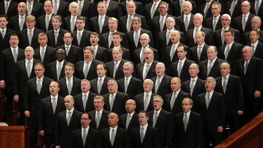 FILE - In this April 2, 2016, file photo, The Mormon Tabernacle Choir performs during the opening session of the two-day Mormon church conference in Salt Lake City. Mormons gather for a twice-yearly conference to hear spiritual guidance from top leaders during a testy presidential election and as society grapples with issues of race and sexuality. (AP Photo/Rick Bowmer, File)