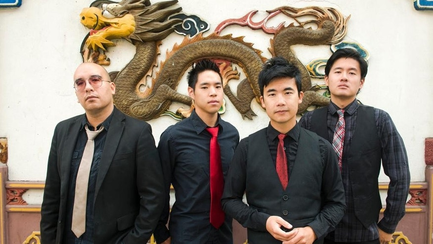 "This photo provided by Anthony Pidgeon, taken Aug. 21, 2015, shows the Asian-American band The Slants, from left, Joe X Jiang, Ken Shima, Tyler Chen, Simon ""Young"" Tam, Joe X Jiang in Old Town Chinatown, Portland, Ore. The Supreme Court will hear a First Amendment challenge over the government's refusal to register offensive trademarks in a case that could affect the Washington Redskins. The justices agreed Thursday, Sept. 29, 2016, to take up a dispute involving an Asian-American rock band called the Slants, but did not act on a separate request to hear the higher-profile Redskins case at the same time. (Anthony Pidgeon/Redferns via AP)"