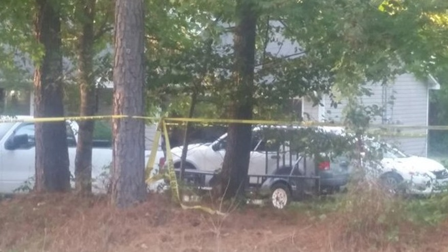 Police tape surrounds home where a young boy was shot and killed Saturday in McDonough, Georgia. (Fox 5 Atlanta)