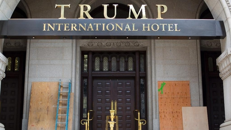 Plywood covers up graffiti at the entrance to the Trump International Hotel in Washington, D.C.