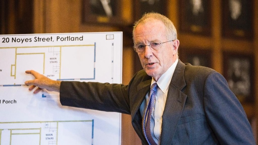 State prosecutor John Alsop details the locations of people within 20 Noyes Street at the time of a fire that killed six during the first day of a manslaughter trial Monday, Oct. 3, 2016, in Portland, Me. Landlord Gregory Nisbet was indicted for manslaughter stemming from the November 2014 fire that killed six people in Portland. (Ben McCanna/Portland Press Herald via AP)