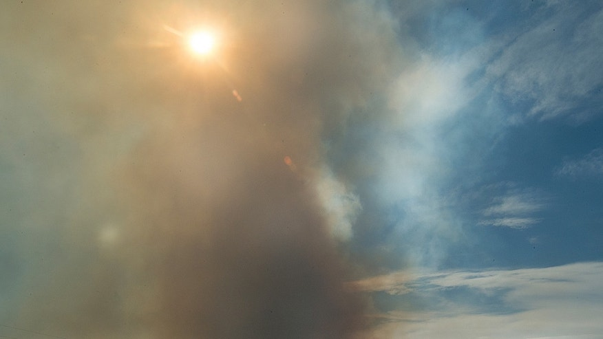 Smoke billows into the sky near Beulah, Colo., during a wildfire that began in the early afternoon on Monday.